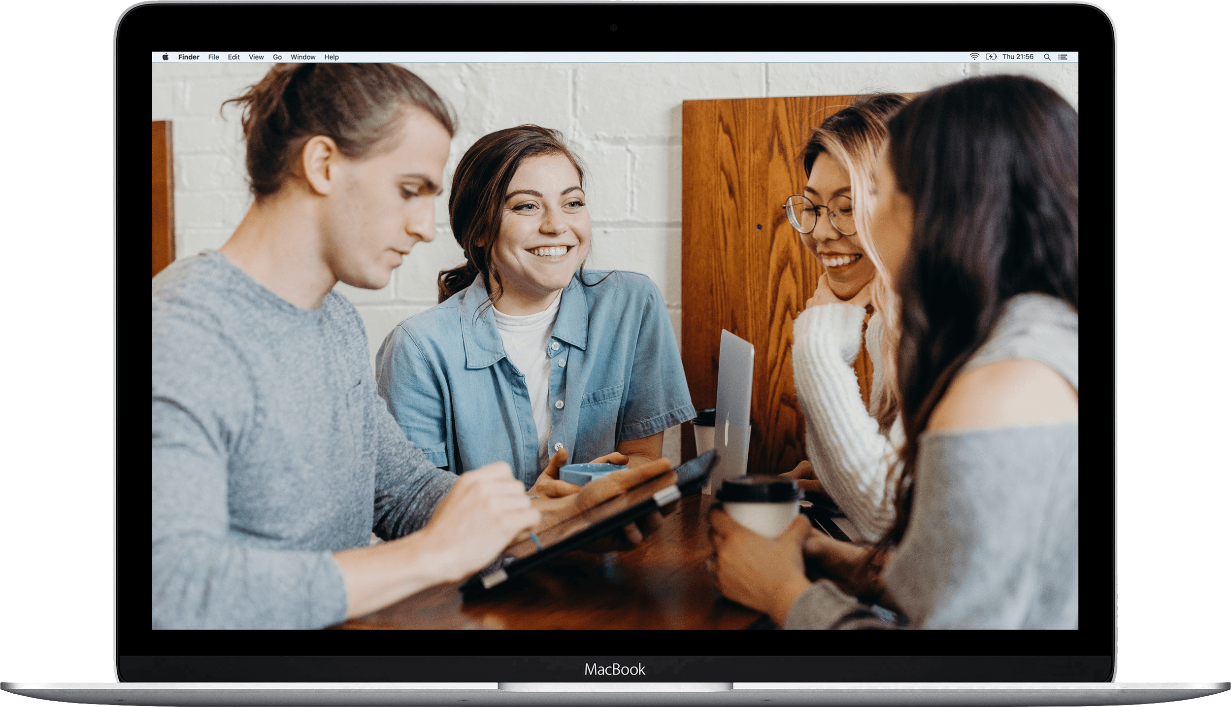 macbook pro with an image of people smiling on the screen